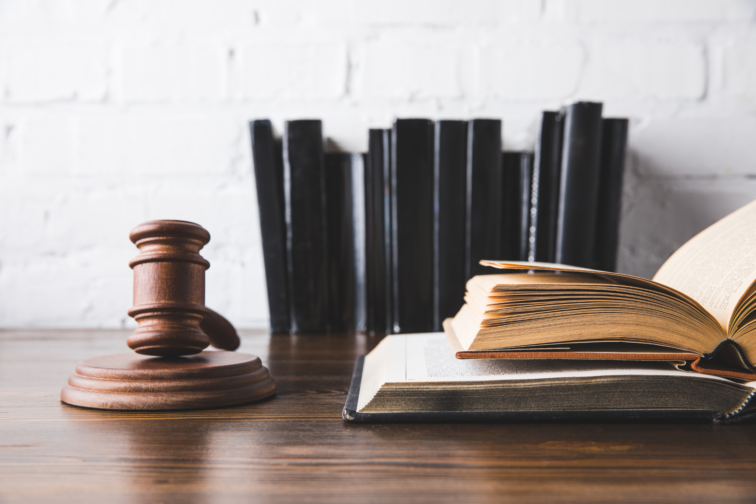 Law books and gavel on desk